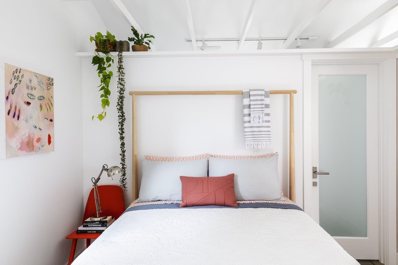 Beech Haus ADU - Bed, Vaulted Ceiling, Exposed Trusses, Plant Shelf, Door to Bathroom