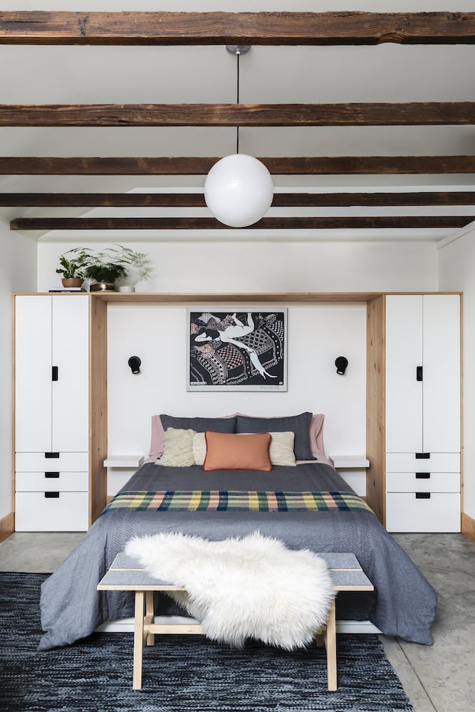 Guest house garage conversion with vaulted ceilings and exposed wood beams