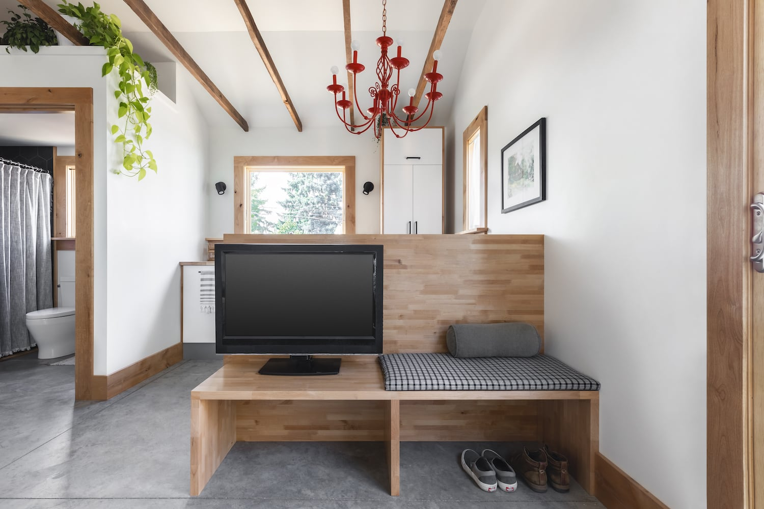 Custom TV station and mud space in re-designed garage conversion to ADU