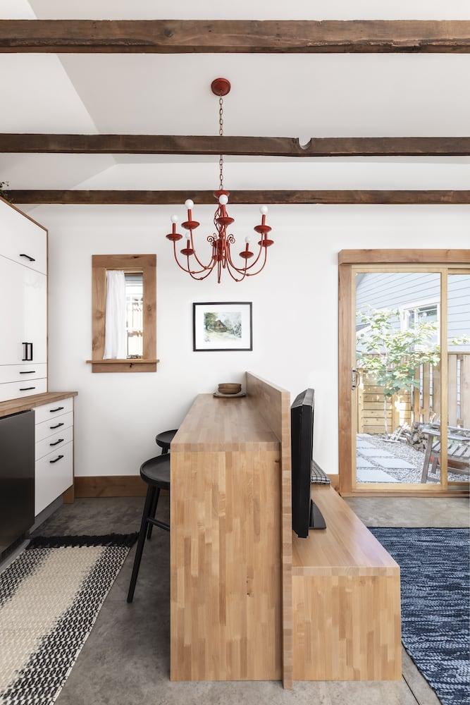 Wood peninsula in Portland re-designed ADU with wood trim doors and windows