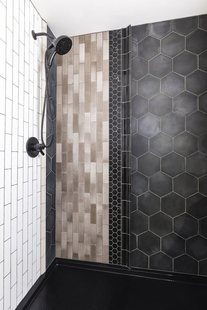 Multi-tile shower with wall-mounted hand shower in Portland guest house