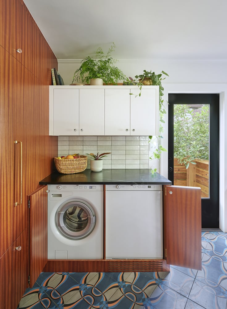 Kitchen with hidden washer and dryer sapele cabinet, soapstone countertop