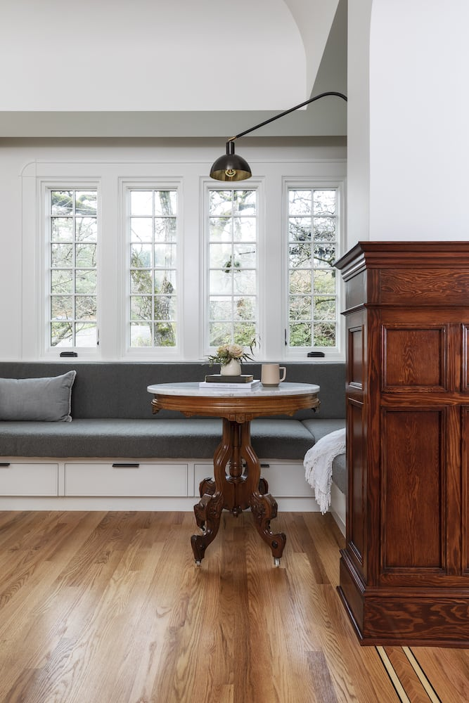 Willamette Heights - traditional kitchen nook, built in banquette, swing arm sconce, wood floor inlay