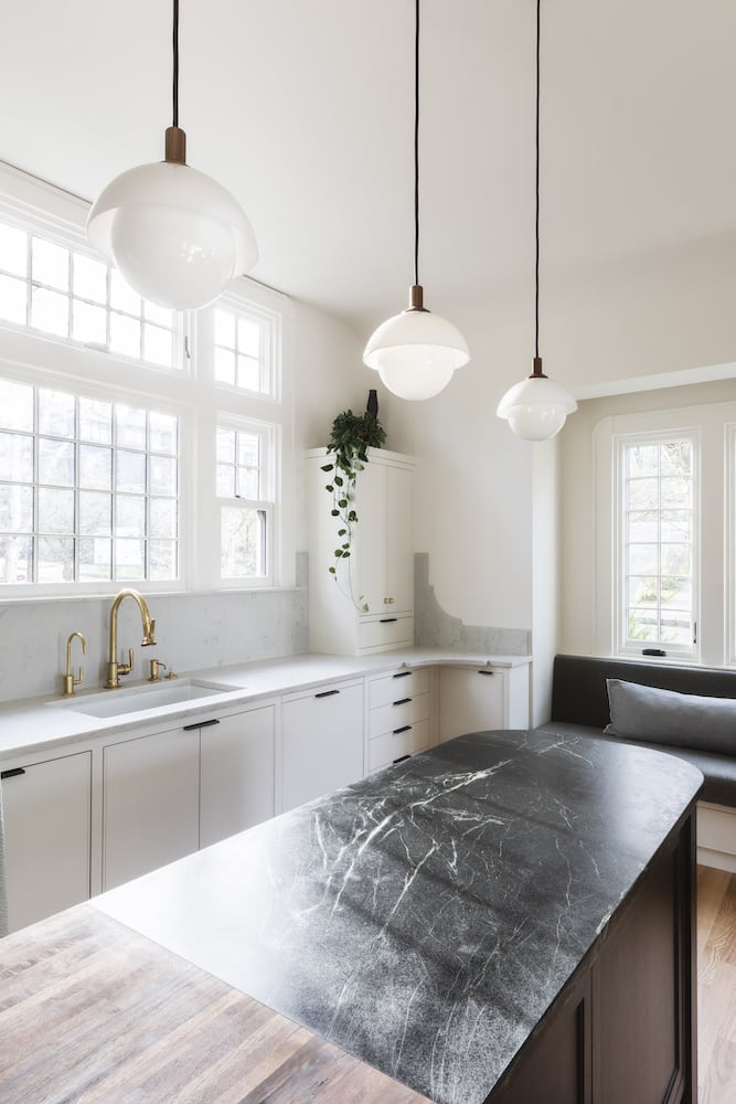 Willamette Heights - traditional white kitchen with dark island, soapstone counters, butcher block counter