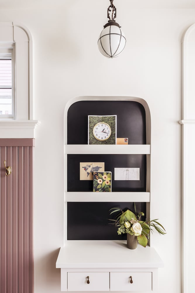 Willamette Heights - mudroom message center with black metal back, ledges, outlet, and two drawers