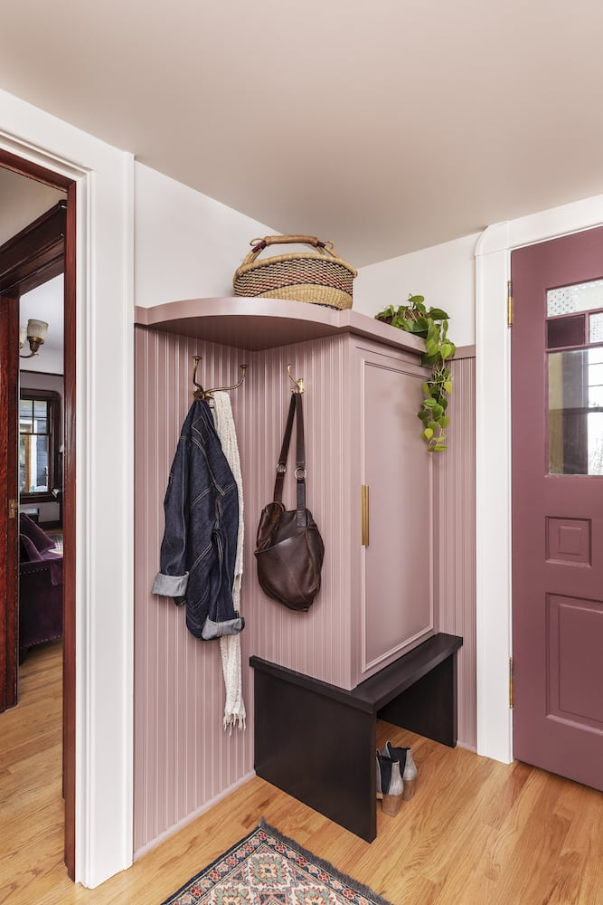 Willamette Heights - mudroom lockers, painted pink cabinets, coat hooks, brass hardware, reclaimed door