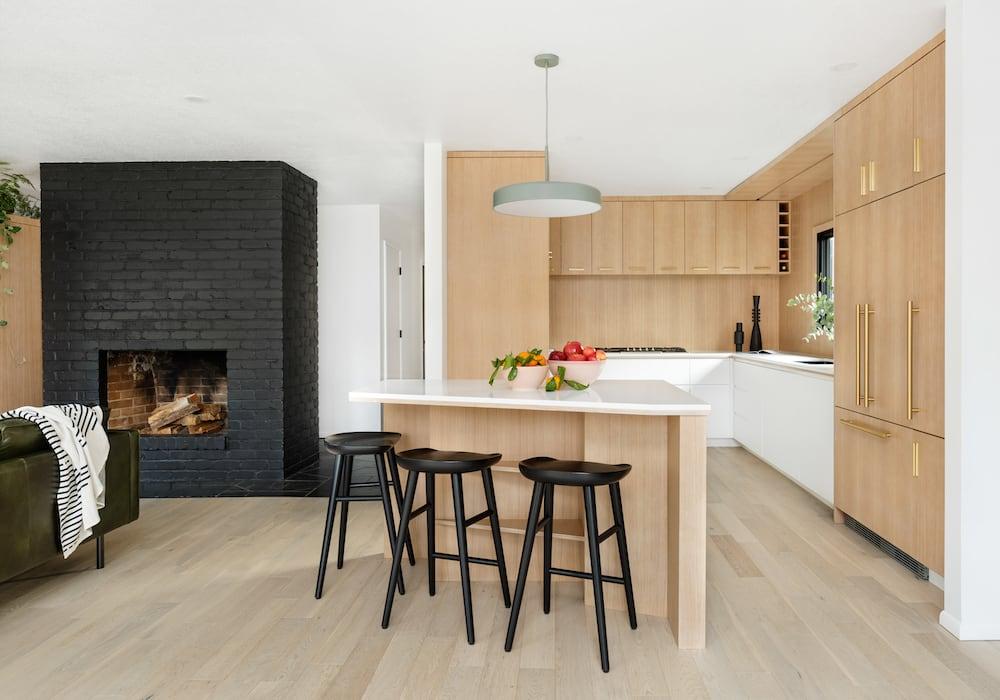 Modern wood kitchen, pentagon island, white counter, green pendant - Rock Creek Modern